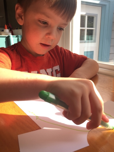 "Designing his shirt with green stripes, which he pointed out was ""easier than drawing the tiger like on his own shirt""."